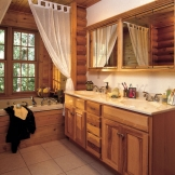 Homecrest_Cabinetry_natural_hickory_cabinets_in_rustic_bathroom.jpg