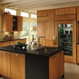 Starmark_Cabinetry_Monroe door style in Cherry finished in Harvest.jpg