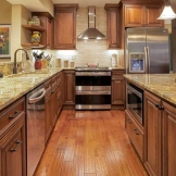 Starmark_Cabinetry_Redcliff door style in Cherry finished in Toffee with Chocolate glaze.jpg