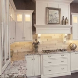 Starmark_Cabinetry_Roseville door style in Maple finished in Marshmallow Cream 3.jpg