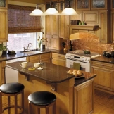 Starmark_Cabinetry_Augusta door style in Maple finished in Butterscotch with Nickel glaze.jpg