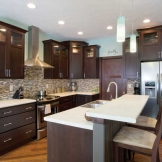 Starmark_Cabinetry_Bedford door style in Cherry finished in Mocha.jpg