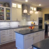 Starmark_Cabinetry_Roseville door style in Maple finished in Marshmallow Cream 4.jpg
